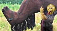 Big Bird Is ticked having to carry his horse. Flips the Bird.