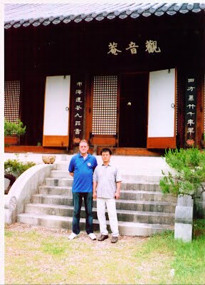 Master Sam with Master Son Young Gul outside a monastery in Daejeon.