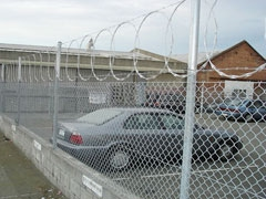 Flat_Wrap_Razor_Wire_Fence_Application_In_Parking_Area