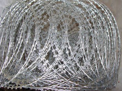 flat wrap razor wire coils, Razor Ribbon, Security fence, Alambre Concertina, El Alambre Navaja - WM WIRE INDUSTRIAL