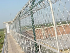 Straight_Razor_Wire_Fence_For_high-security_prisons, Concertina, Security fencing, Redes Laminadas, Concertina para muros, Razor Ribbon, Alambre de Navajas - WM WIRE INDUSTRIAL