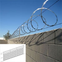 the wall topped with single coil razor barbed wire