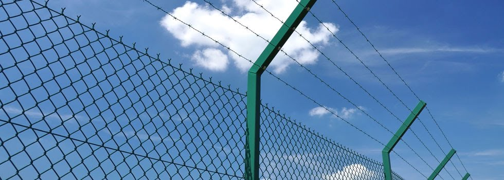 Barbed wire security fencing on chain link fence